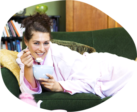 woman eating ice cream on sofa